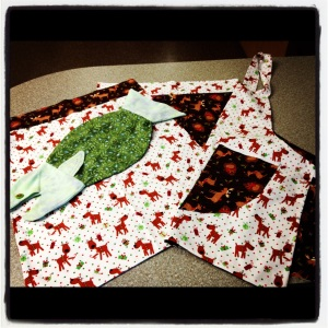 I wanted to make my gifts last year and these were the gift packages I created. Pillowcases, apron, and a fish bag.